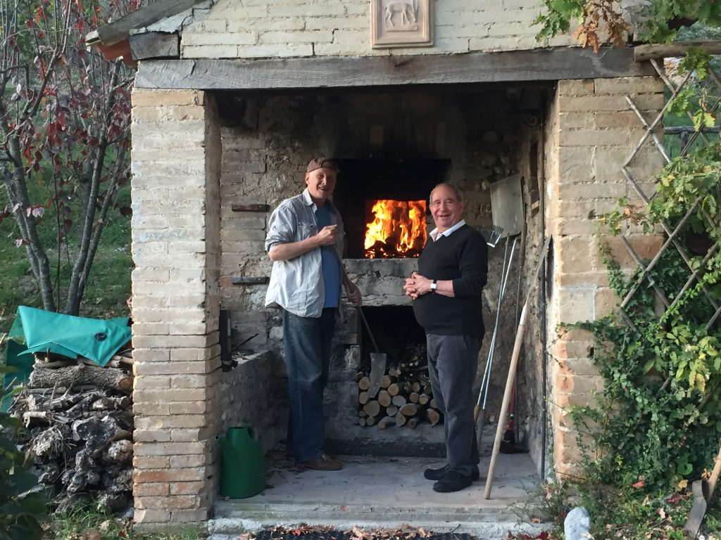 My dad and Bruce happily getting the fire going