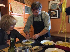 The owner, Stefano, shaving truffles over his fresh pasta