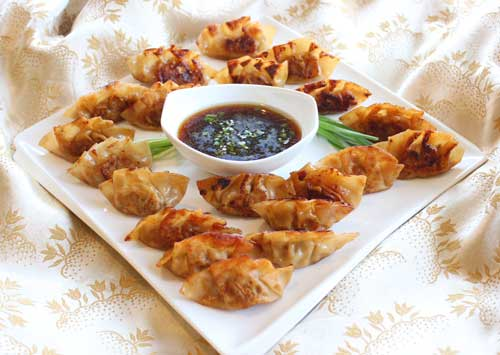 Under the Table (featuring Pork and Ginger Potstickers)